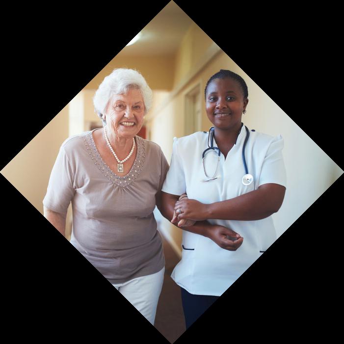 elder female and nurse assisting her