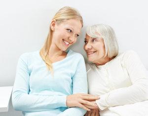 elder and staff smiling